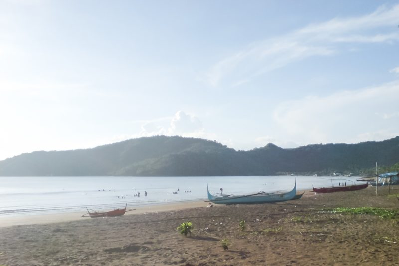 Fishing boats on the shore of Calayo beach