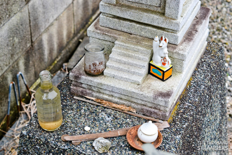 Close-up of a small shrine on the road in Kawagoe